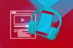 Smart phone and laptop with earphones on red background