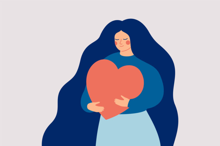 Young woman embraces a big red heart with mindfulness and love. Self acceptance and confidence concept.