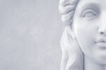 Marble sculpture of a pleasant woman. Handcrafted modern object in classical ancient greek style. Copyspace for custom text.
