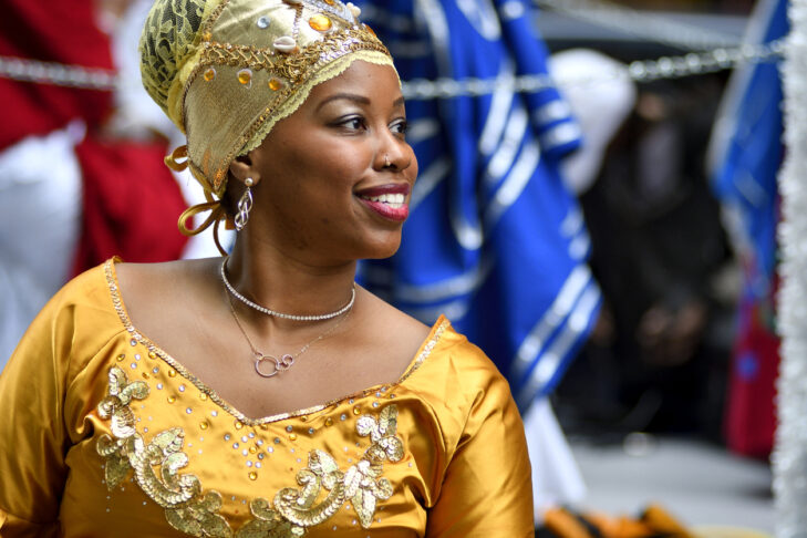 Philadelphia, PA, USA - June 23, 2018; Female in traditional attire smiles as she participated in the annual Juneteenth parade in Center City Philadelphia, PA, on June 23, 2018. The Juneteenth Independence Day or Freedom Day commemorates the announcement of abolition of slavery on June 19, 1865.