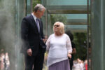 Gov. Charlie Baker walks through the memorial with Holocaust Survivor Janet Singer Applefield after an announcement of a new website and interactive features at the New England Holocaust Memorial on July 8, 2021 in Boston, MA. (Staff Photo By Nancy Lane/MediaNews Group/Boston Herald)