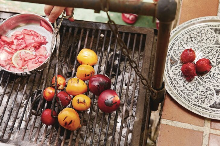 """Grilled stone fruits with rosemary and rose syrup from """"Chasing Smoke: Cooking Over Fire Around the Levant"""" by Sarit Packer and Itamar Srulovich (Photo: Patricia Niven)"""