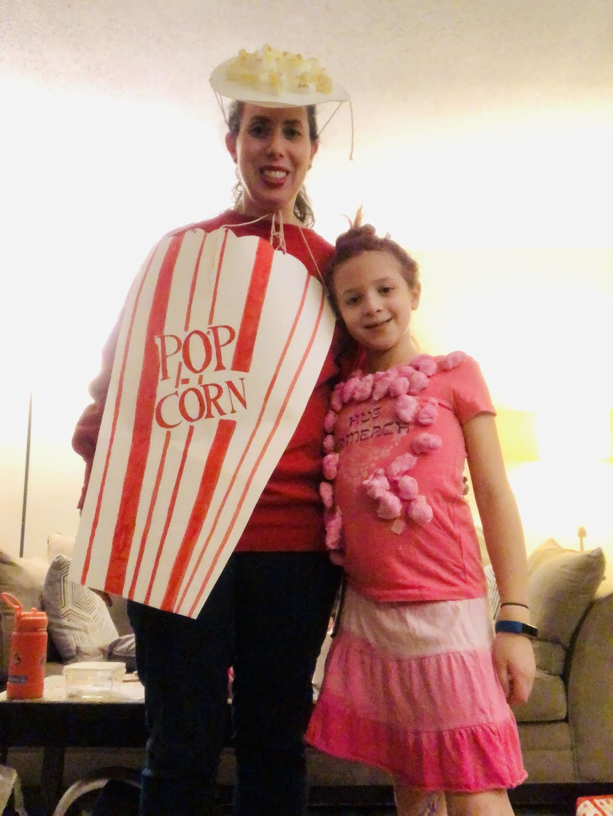 Sarah and Gali Feinberg in their Purim costumes (popcorn and cotton candy) (Courtesy photo)