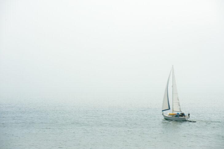 Sailing in the dense fog in Atlantic ocean near Bass Harbor, Maine, USA