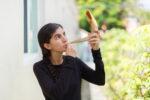Woman blowing shofar for Rosh Hashana