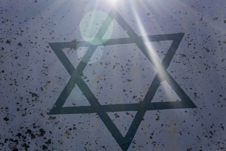 Symbol of Judaism or Star of David. Six-pointed star in a centre of composition in beams of the sun.