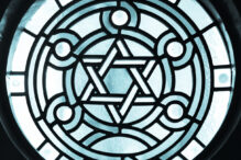 Stain-glass Window in 19 century Synagogue. Stain-glass with a dramatic back light overtone. The Star of David, known in Hebrew as the Shield of David or Magen David, is the quintessential symbol of Jewish identity.